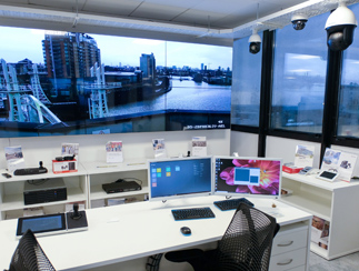 Two computer monitors in an office building